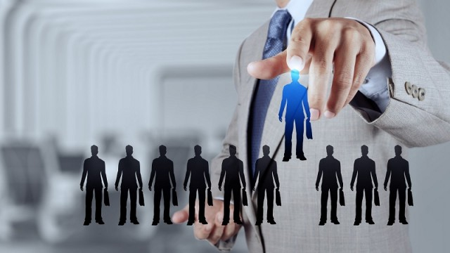 businessman hand choosing people icon  as human resources concep