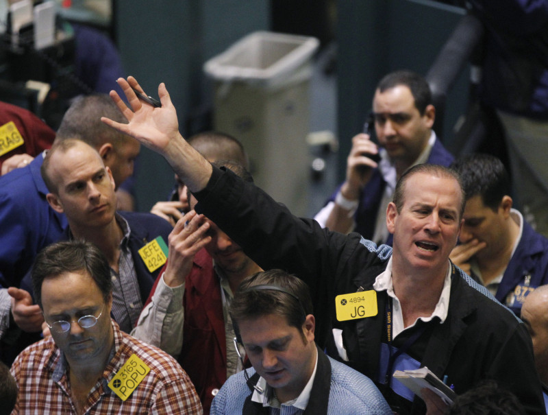 Traders work in the oil options pit on the floor of the New York Mercantile Exchange in New York, February 24, 2011. Oil surged to almost $120 a barrel and the safe-haven Swiss franc hit a record high on Thursday on fears turmoil in Libya could spread, but gold eased on talk Saudi Arabia could boost its crude output.   REUTERS/Brendan McDermid (UNITED STATES - Tags: ENERGY BUSINESS) - RTR2J222